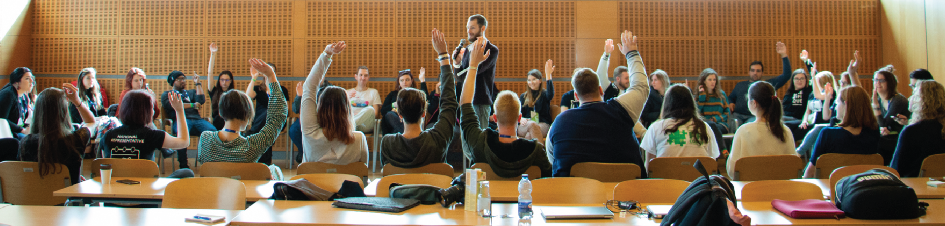 Students raising hands during a workshop